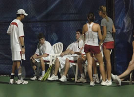 Players gather around Captain Michael Ellman during a night match